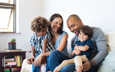 multi-racial couple with two children in living room