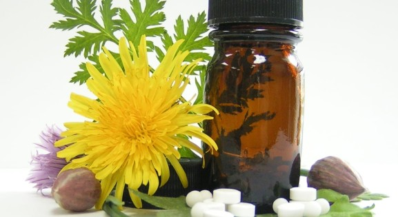 dandelion, capsules, and brown bottle