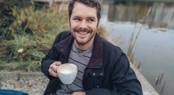 Man outdoors with a Cup of Coffee